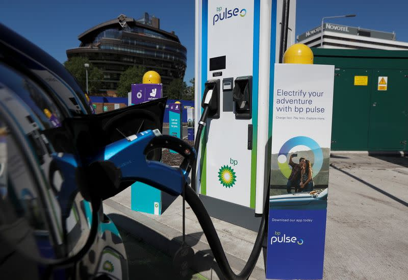 An electric powered taxi is seen being charged at a BP Pulse electric vehicle charging point in London