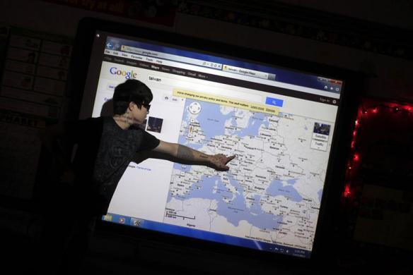 Ian Chuang, a foreign exchange student from Taoyuan,Taiwan, uses a map to show students at Grant-Deuel School where the other exchange students are from in Revillo, South Dakota February 13, 2012.