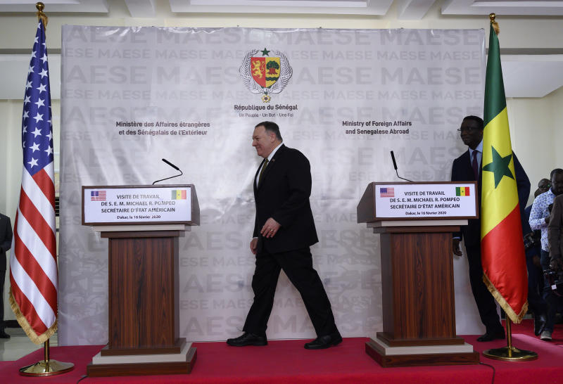 US Secretary of State Mike Pompeo and Senegal's Foreign Affairs minister Amadou Ba arrive for a press conference with Senegal's Foreign Affairs minister at the Presidential Palace, in Dakar, Senegal, Sunday, Feb. 16, 2020, part of Pompeo's first visit to sub-Saharan Africa during which he will seek to lay out a positive vision for US cooperation with the continent where China has been increasingly active. (Andrew Carballero-Reynolds/Pool Photo via AP)