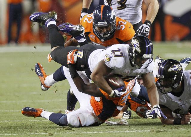 Baltimore Ravens Ray Rice (27) is tackled by Denver Broncos Duke Ihenacho (33) during the second quarter in their NFL football game in Denver, Colorado September 5, 2013. REUTERS/Rick Wilking (UNITED STATES - Tags: SPORT FOOTBALL)