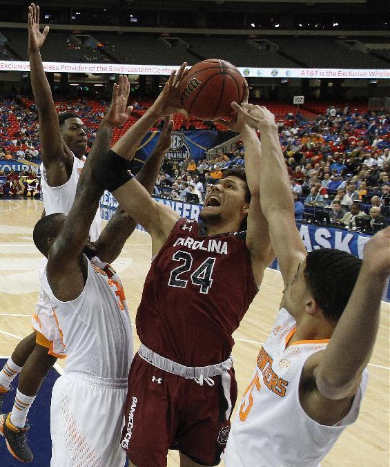 South Carolina forward Michael Carrera (24) shoots through a Tennessee defense during the first half of an NCAA college basketball game in the quarterfinal round of the Southeastern Conference men's tournament, Friday, March 14, 2014, in Atlanta. (AP Photo/Steve Helber)