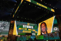 Images of Georgia cornerback Eric Stokes are displayed on stage after he was chosen with by the Green Bay Packers with the 29th pick in the NFL football draft Thursday April 29, 2021, in Cleveland. (AP Photo/Tony Dejak)