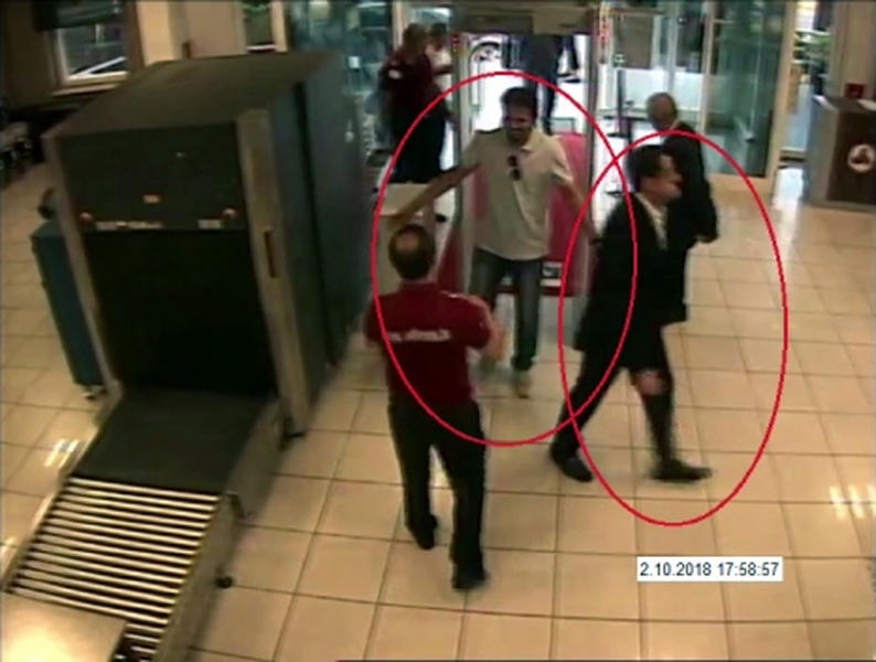 "ADDS NAME OF SUSPECT ON RIGHT- In a frame from surveillance camera footage taken Oct. 2, 2018, and published Thursday, Oct. 18, 2018, by the pro-government Turkish newspaper Sabah, a man identified by Turkish officials as Maher Abdulaziz Mutreb, right, walks at Ataturk Airport in Istanbul. Writer Jamal Khashoggi disappeared at the Saudi consulate in Istanbul on the same day. Saudi Arabia, which initially called the allegations ""baseless,"" has not responded to repeated requests for comment from The Associated Press over recent days, including on Thursday over Mutreb's identification. (Sabah via AP)"