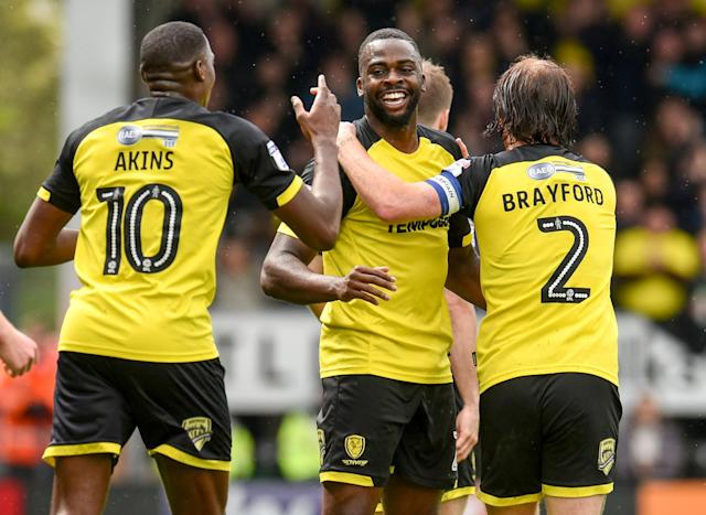 "Soccer Football - Championship - Burton Albion vs Bolton Wanderers - Pirelli Stadium, Burton, Britain - April 28, 2018 Burton Albion's Hope Akpan celebrates scoring their first goal with team mates Action Images/Paul Burrows EDITORIAL USE ONLY. No use with unauthorized audio, video, data, fixture lists, club/league logos or ""live"" services. Online in-match use limited to 75 images, no video emulation. No use in betting, games or single club/league/player publications. Please contact your account representative for further details."