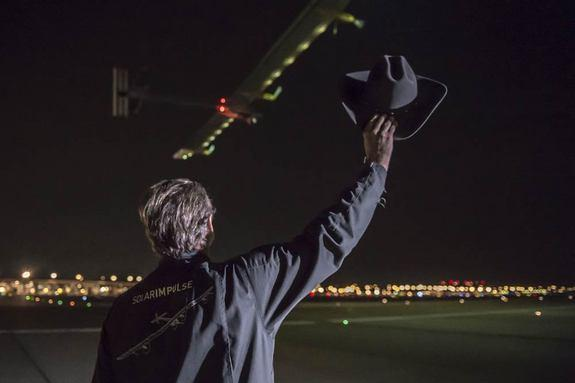 Solar Impulse co-founder Andre? Borschberg waves his cowboy hat as the solar-powered aircraft departs Dallas on June 3, 2013.