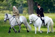 "<p>As an avid horseback rider, it isn't rare for the Queen to enjoy a ride in the saddle — <a href=""https://www.usatoday.com/story/entertainment/celebrities/2020/05/31/queen-elizabeth-rides-horse-emerges-coronavirus-quarantine-windsor-castle/5301424002/"" rel=""nofollow noopener"" target=""_blank"" data-ylk=""slk:even at the age of 96"" class=""link rapid-noclick-resp"">even at the age of 96</a>. At the end of the day, she's just your normal horse lover. Here, she rides at Windsor Castle in 2006. </p>"