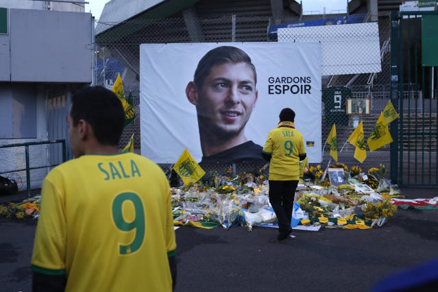 "FILE - In this Wednesday, Jan. 30, 2019 file photo, Nantes soccer team supporters stand by a poster of Argentinian player Emiliano Sala and reading ""Let's keep hope"" outside La Beaujoire stadium in Nantes, western France. FIFA says Cardiff must pay 6 million euros ($6.5 million) to Nantes as a first installment of the transfer fee for Emiliano Sala, agreed in January before he died in an airplane crash. FIFA says on Monday, Sept. 30 its players' status panel ""never lost sight of the specific and unique circumstances of this tragic situation"" in the dispute between the two clubs. (AP Photo/Thibault Camus, file)"
