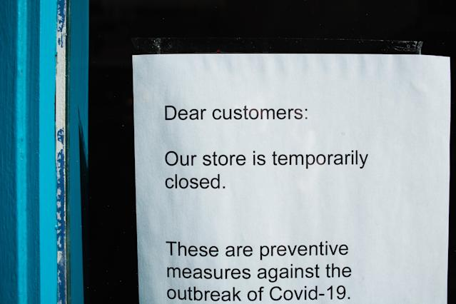A notice informs customers of the closure of a clothing store on Carnaby Street in London, England. (David Cliff/NurPhoto via Getty Images)