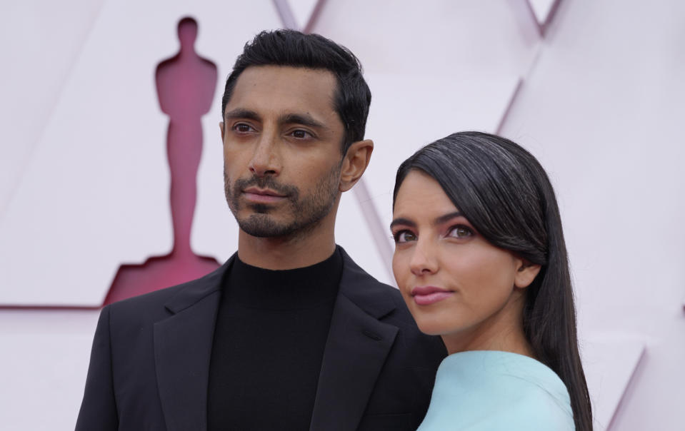 Riz Ahmed, left, and Fatima Farheen Mirza arrive at the Oscars on Sunday, April 25, 2021, at Union Station in Los Angeles. (AP Photo/Chris Pizzello, Pool)