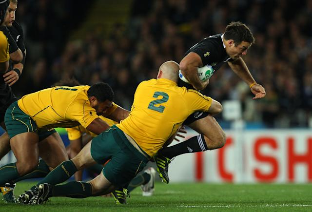 AUCKLAND, NEW ZEALAND - OCTOBER 16: Richard Kahui of the All Blacks is tackled by Sekope Kepu (L) and Stephen Moore (C) of the Wallabies during semi final two of the 2011 IRB Rugby World Cup between New Zealand and Australia at Eden Park on October 16, 2011 in Auckland, New Zealand. (Photo by Cameron Spencer/Getty Images)