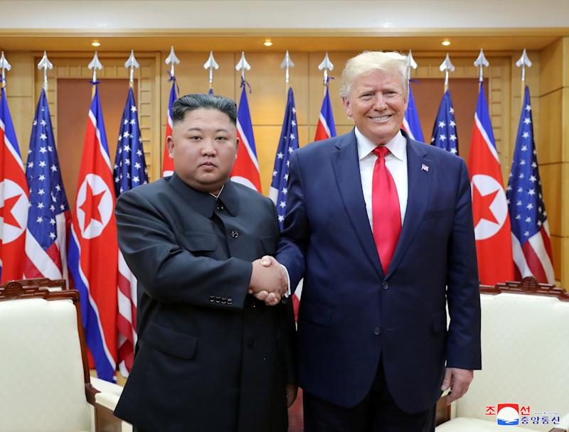 U.S. President Donald Trump shakes hands with North Korean leader Kim Jong Un as they meet at the demilitarized zone separating the two Koreas, in Panmunjom, South Korea, June 30, 2019. KCNA via REUTERS ATTENTION EDITORS - THIS IMAGE WAS PROVIDED BY A THIRD PARTY. REUTERS IS UNABLE TO INDEPENDENTLY VERIFY THIS IMAGE. NO THIRD PARTY SALES. SOUTH KOREA OUT. NO COMMERCIAL OR EDITORIAL SALES IN SOUTH KOREA.