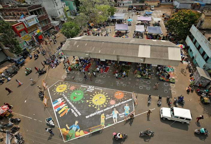 """A graffiti on a road depicting coronavirus to create awareness about social distancing during a 21-day nationwide lockdown in Chennai, India, on April 9, 2020. <p class=""""copyright"""">REUTERS/P. Ravikumar</p>"""
