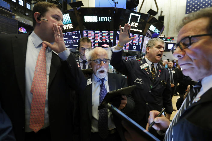 New York Stock Exchange Floor Governor Brendan Connolly, left, works with traders Peter Tuchman, John Panin and Sal Suarino, second left to right, on the floor of the NYSE, Monday, March 9, 2020. The Dow Jones Industrial Average plummeted 1,500 points, or 6%, following similar drops in Europe after a fight among major crude-producing countries jolted investors already on edge about the widening fallout from the outbreak of the new coronavirus. (AP Photo/Richard Drew)