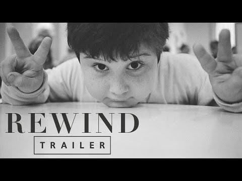 """<p>Autobiographical tales of trauma don't come much more wrenching than <em>Rewind</em>, director Sasha Neulinger's non-fiction investigation into his painful childhood. A bright and playful kid, Neulinger soon morphed into a person his parents didn't recognize – a change, they soon learned, that was brought about by the constant sexual abuse he (and his younger sister Bekah) was suffering at the hands of his cousin and two uncles, one of whom was a famed New York City temple cantor. Its formal structure intrinsically wedded to its shocking story, Neulinger's film reveals its monstrous particulars in a gradual bits-and-pieces manner that echoes his own childhood process of articulating his experiences to others. Not just a portrait of Neulinger's internalized misery, it's also a case study of how sexual misconduct is a crime passed on from generation to generation, a fact borne out by further revelations about his father's upbringing alongside his assaultive brothers. Most of all, though, it's a saga about perseverance and bravery, two qualities that Neulinger – then, and now – exhibits in spades.</p><p><a class=""""link rapid-noclick-resp"""" href=""""https://www.amazon.com/Rewind-Sasha-Joseph-Neulinger/dp/B086MRB56X/?tag=syn-yahoo-20&ascsubtag=%5Bartid%7C10054.g.29500577%5Bsrc%7Cyahoo-us"""" rel=""""nofollow noopener"""" target=""""_blank"""" data-ylk=""""slk:Watch Now"""">Watch Now</a></p><p><a href=""""https://www.youtube.com/watch?v=Dx0q7ETJRAI"""" rel=""""nofollow noopener"""" target=""""_blank"""" data-ylk=""""slk:See the original post on Youtube"""" class=""""link rapid-noclick-resp"""">See the original post on Youtube</a></p>"""