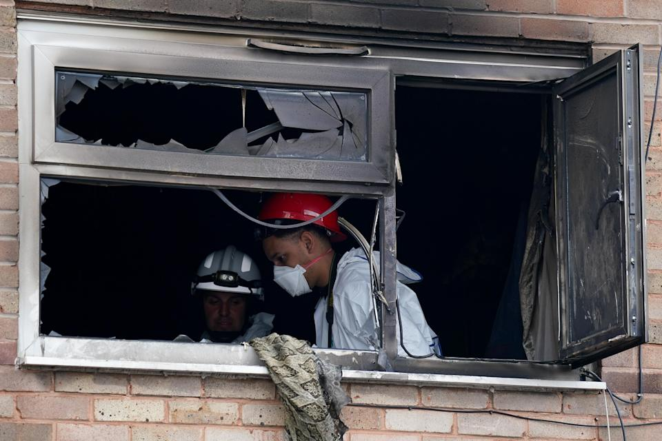 Fire investigation officers at the property (Jacob King/PA) (PA Wire)