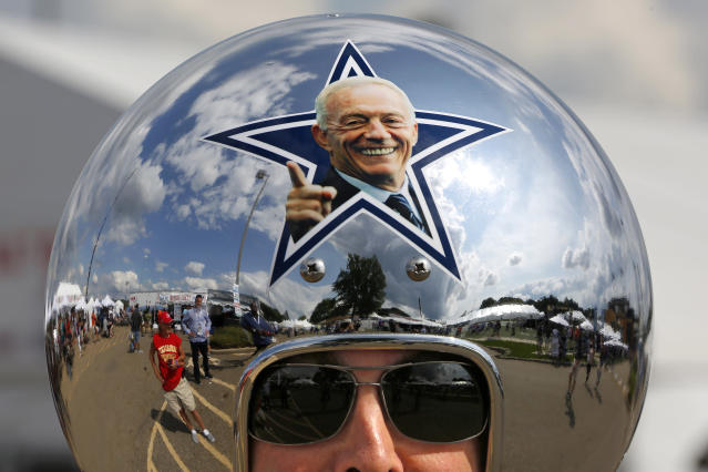 Cowboys fan Gregg Wilson, of Dallas, arrives for the Pro Football Hall of Fame inductions, including that of Cowboys owner Jerry Jones, whose photo is on the helmet. (AP Photo/Gene J. Puskar)