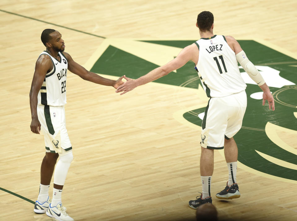 Milwaukee Bucks stars Khris Middleton and Brook Lopez made up for Giannis Antetokounmpo's absence in a Game 5 win over the Atlanta Hawks. (Patrick McDermott/Getty Images)