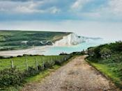"""<p>A range of chalk hills that extend for a whopping 260 square miles across the south-eastern coastal counties of England from Hampshire to East Sussex, the South Downs are a must-see when considering a day trip out of the Big Smoke. </p><p>There are several ways to explore the Downs but we suggest doing so by foot on the Seven Sisters <a href=""""https://www.countryfile.com/go-outdoors/walks/walk-seven-sisters-east-sussex/"""" rel=""""nofollow noopener"""" target=""""_blank"""" data-ylk=""""slk:route"""" class=""""link rapid-noclick-resp"""">route</a> which covers approximately 3.7 miles (2 hours) and overlooks the sea. </p><p><strong>Distance from London</strong>: 61.4 miles</p><p><strong>How to get there</strong>: London Waterloo to Petersfield via <a href=""""https://www.thetrainline.com/book/results?journeySearchType=single&origin=bc3771e2481f260d7c07c163139d187d&destination=efe712fb159e3d3bc15e08a48e92dcc2&outwardDate=2020-07-16T14%3A15%3A00&outwardDateType=departAfter&passengers%5B%5D=1990-07-16&selectExactTime=true&selectedOutward=H3qur204aA0%3D%3Aoxzcuqkc0U0%3D"""" rel=""""nofollow noopener"""" target=""""_blank"""" data-ylk=""""slk:train"""" class=""""link rapid-noclick-resp"""">train</a> (1hr 3mins)</p>"""