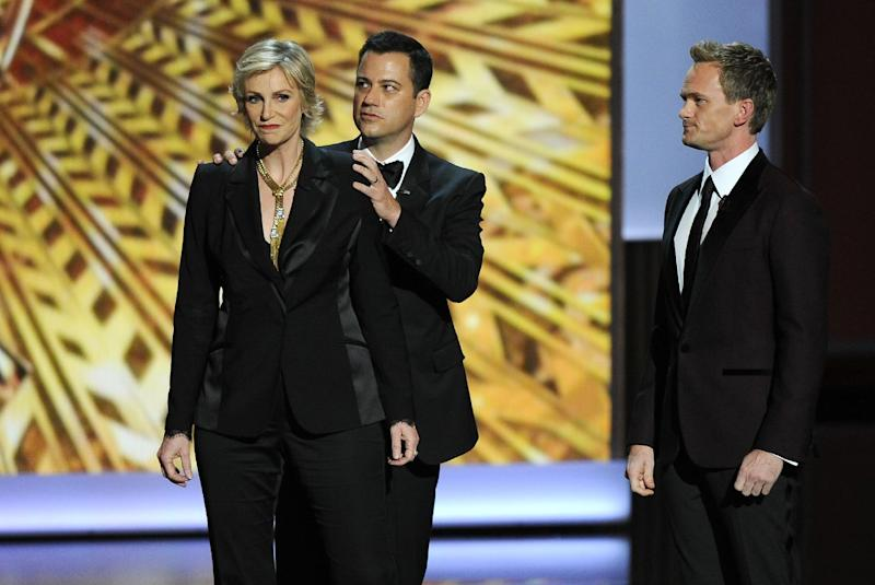Jane Lynch, from left, Jimmy Kimmel, and Neil Patrick Harris appear on stage at the 65th Primetime Emmy Awards at Nokia Theatre on Sunday Sept. 22, 2013, in Los Angeles. (Photo by Chris Pizzello/Invision/AP)