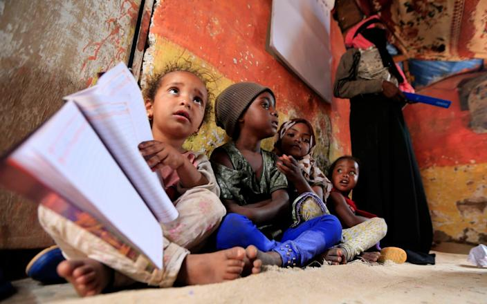 Children will be hit not just by school closures but by rising poverty globally - MOHAMMED HUWAIS/AFP