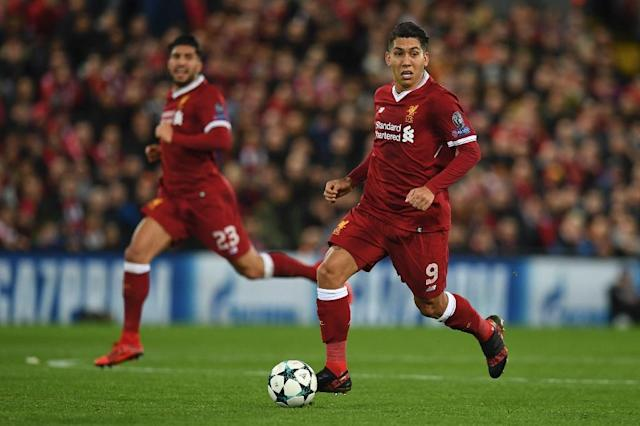 Liverpool's Roberto Firmino (R) runs with the ball during their match against Spartak Moscow in Liverpool, north-west England on December 6, 2017 (AFP Photo/Paul ELLIS)