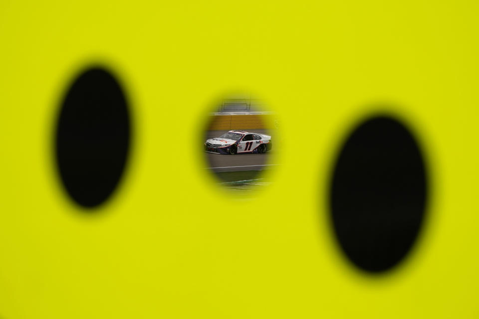 Denny Hamlin drives during a NASCAR Cup Series auto race Sunday, March 7, 2021, in Las Vegas. (AP Photo/John Locher)