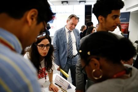 Britain's Chief Trade Negotiation Adviser Crawford Falconer watches students take part in a mock trade negotiation at Harris Westminster Sixth Form college in central London