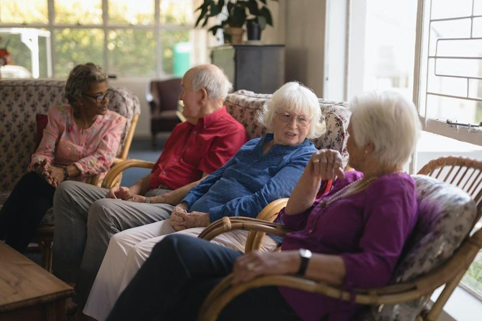 Four older adults sitting
