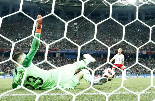 Croatia goalkeeper Danijel Subasic saves a penalty by Denmark's Nicolai Jorgensen during the penalty shootout of the round of 16 match between Croatia and Denmark at the 2018 soccer World Cup in the Nizhny Novgorod Stadium, in Nizhny Novgorod , Russia, Sunday, July 1, 2018. (AP Photo/Martin Meissner)