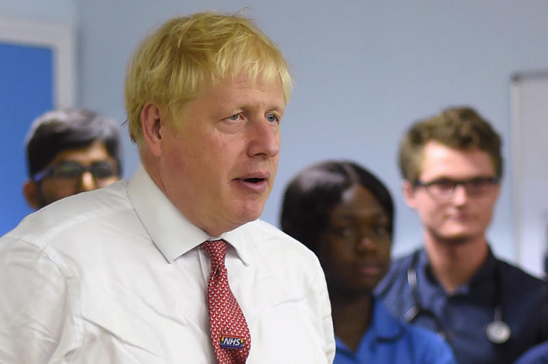 Britain's Prime Minister Boris Johnson speaks to nurses and hospital workers during his visit to Watford General hospital in Watford, north of London on on October 7, 2019. - British Prime Minister Boris Johnson has warned French President Emmanuel Macron he will not delay Brexit beyond October 31, underlining that his latest proposals are a last chance to reach a deal, a Downing Street spokesman said on Sunday. (Photo by Peter Summers / POOL / AFP) (Photo by PETER SUMMERS/POOL/AFP via Getty Images)
