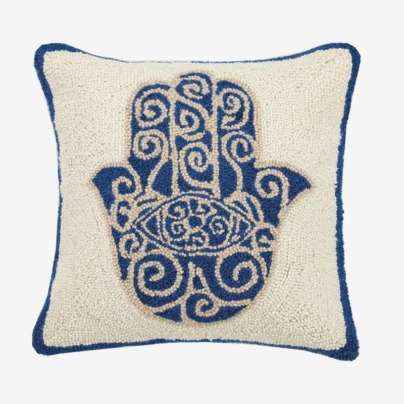"""<p><strong>Jungalow</strong></p><p>jungalow.com</p><p><strong>$55.00</strong></p><p><a href=""""https://www.jungalow.com/collections/hook-pillows-piper/products/hamsa-hook-pillow-by-justina-blakeney"""" rel=""""nofollow noopener"""" target=""""_blank"""" data-ylk=""""slk:Shop Now"""" class=""""link rapid-noclick-resp"""">Shop Now</a></p><p>Dad's idea of decorating is a baseball poster and a set of string lights. Gift him a suave throw pillow that will dress up any room in the house.</p>"""