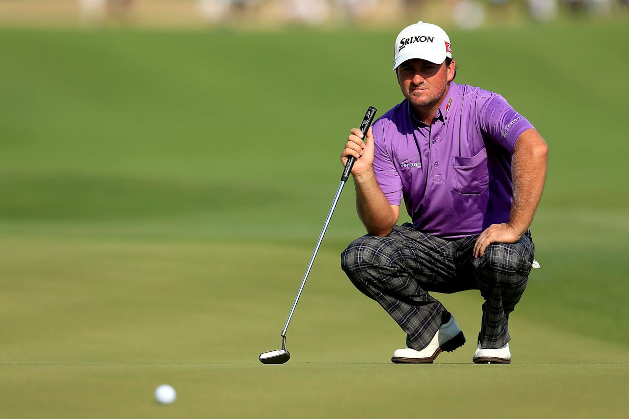 Graeme McDowell of Northern Ireland lines up a putt on the 18th green during Round Three of the 94th PGA Championship at the Ocean Course on August 12, 2012 in Kiawah Island, South Carolina.  (Photo by David Cannon/Getty Images)