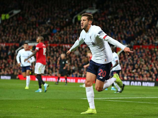Adam Lallana celebrates after scoring Liverpool's late equaliser: Getty