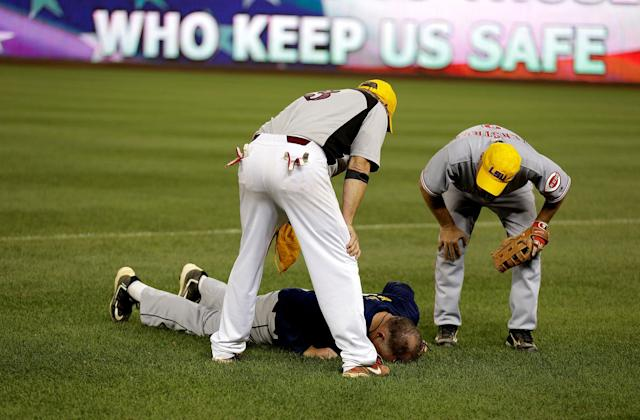<p>Rep. Tom Rooney (R-FL) lies on the field after a ball hit him in the face during the annual Congressional Baseball Game at Nationals Park in Washington, June 15, 2017. (Photo: Joshua Roberts/Reuters) </p>