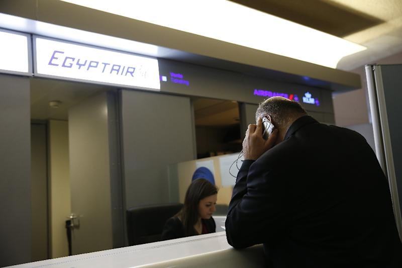 People wait in front of the Egyptair desk at the Roissy-Charles De Gaulle airport in Roissy-en-France near Paris on May 19, 2016 (AFP Photo/Thomas Samson)