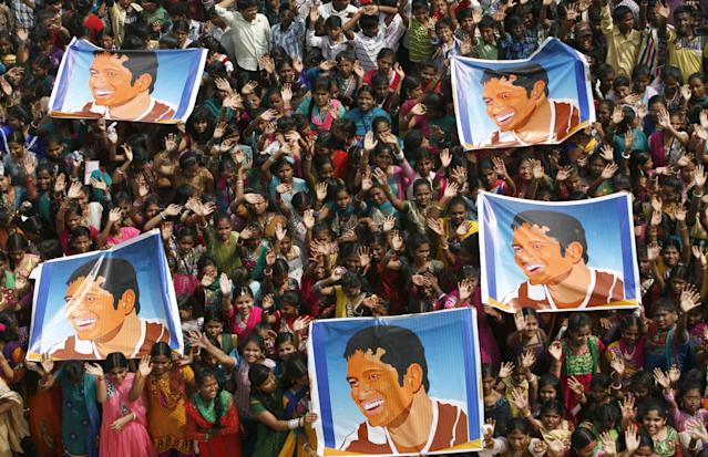 Indian school children display posters of Indian cricket star Sachin Tendulkar as they gather to honor him in Chennai, India, Thursday, Nov. 14, 2013. Tendulkar plays his world-record 200th and last test from Thursday in a hometown stadium for which tickets could have been sold 10 times over. (AP Photo/Arun Sankar K)