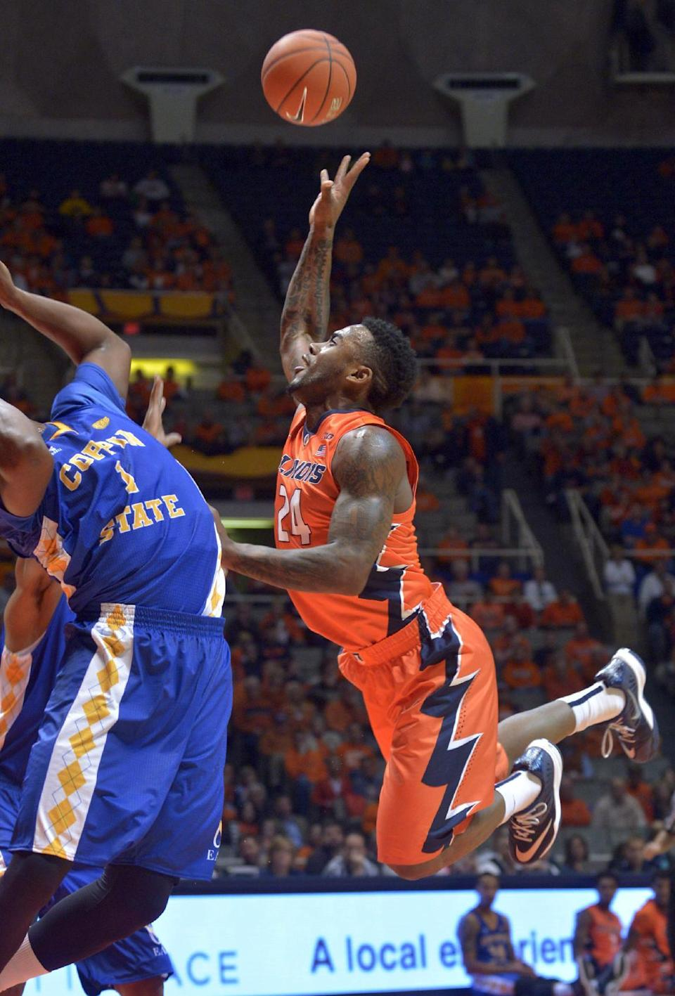 Illinois' guard Rayvonte Rice (24) goes up for a shot in front of Coppin State's forward Dallas Gary (1) during an NCAA college basketball game in Champaign, Ill., on Sunday, Nov. 16, 2014. (AP Photo/Robin Scholz)