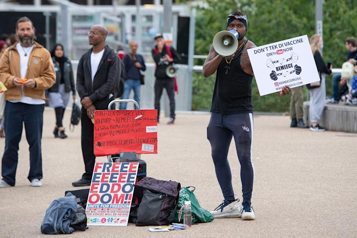 An anti vaccination protestor outside an NHS Vaccination Clinic at West Ham's London Stadium in Stratford, east London. The NHS is braced for high demand as anyone in England over the age of 18 can now book a Covid-19 vaccination jab. Picture date: Saturday June 19, 2021.
