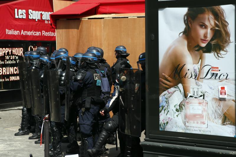 "Riot police officers patrol during a May Day demonstration in Paris, Wednesday, May 1, 2019. French authorities announced tight security measures for May Day demonstrations, with the interior minister saying there was a risk that ""radical activists"" could join anti-government yellow vest protesters and union workers in the streets of Paris and across the country. (AP Photo/Francois Mori)"