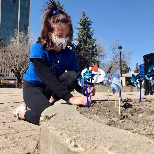 Sarah Labadie placed pinwheels in front of City Hall to honour victims of child sex abuse.