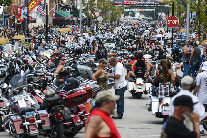 Motorcycles and people crowd Main Street during the 80th Annual Sturgis Motorcycle Rally on August 7, 2020 in Sturgis, South Dakota. According to photos, masks were not widely worn and social distancing was not practiced. / Credit: Michael Ciaglo / Getty Images