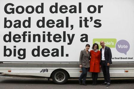 Labour Party MP Chuka Umunna, Liberal Democrat MP Layla Moran and Green MP Caroline Lucas pose in front of a poster to launch the Peoples Vote advertising campaign in London, Britain April 15, 2018. REUTERS/Simon Dawson