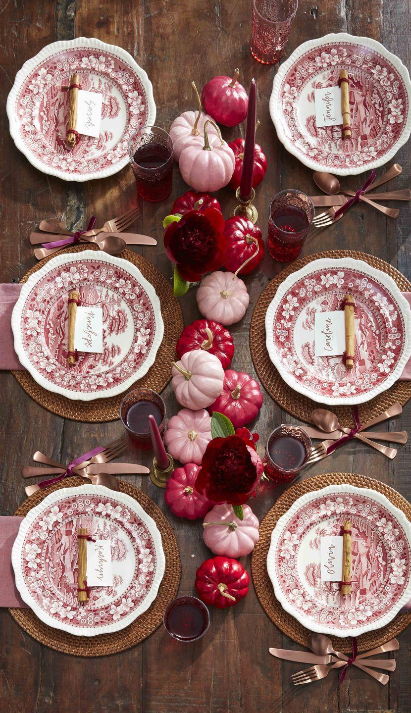 <p>Paint small white pumpkins in differing shades of red and pink to create a lovely ombre effect down the center of the table. Add single maroon flowers in bud vases here and there for a light floral touch. </p>