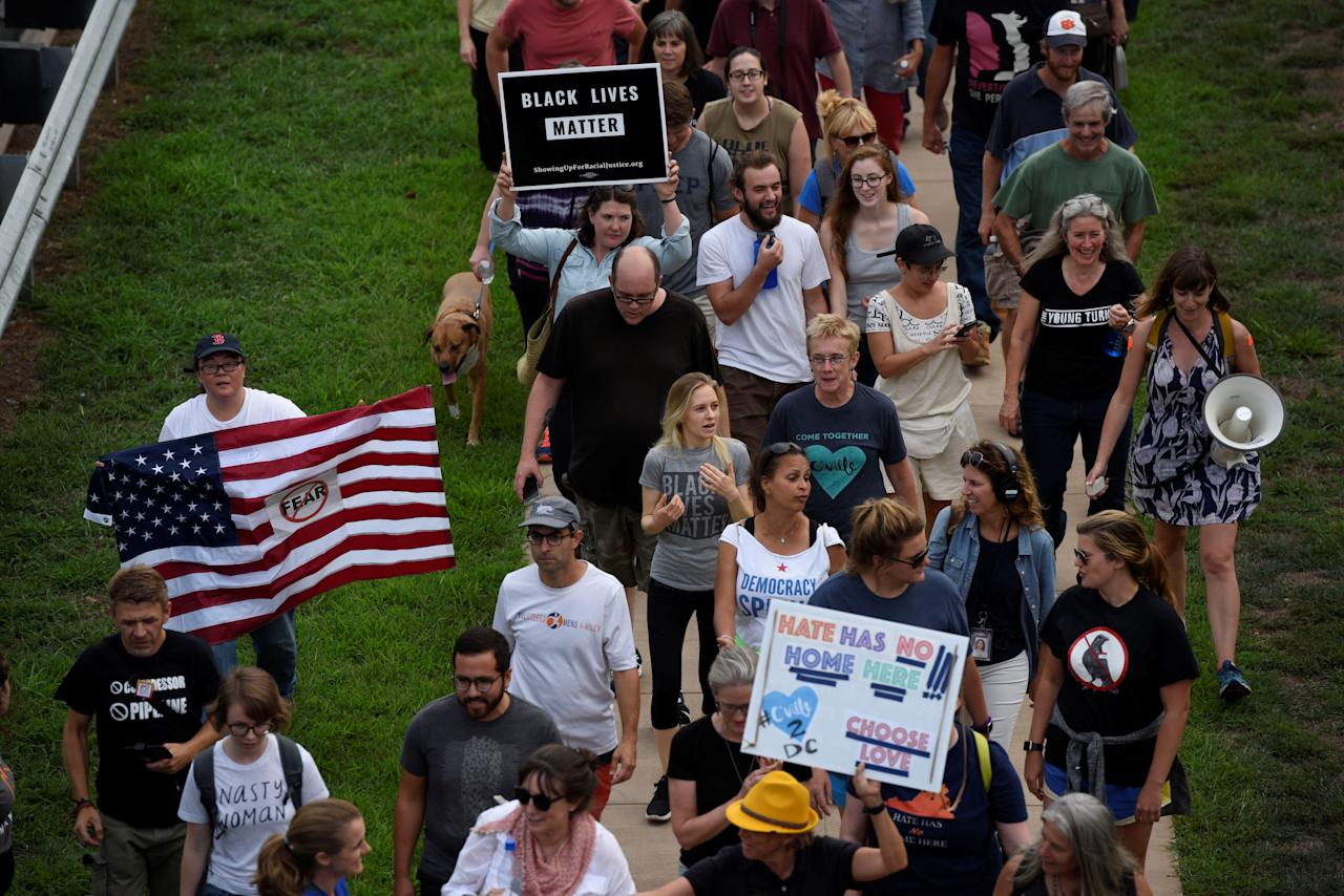 "<p>Participants of ""Charlottesville to D.C: The March to Confront White Supremacy"" walk on Emmet Street N during a ten-day trek to the nation's capital from Charlottesville, Va., Aug. 28, 2017. (Photo: Sait Serkan Gurbuz/Reuters) </p>"