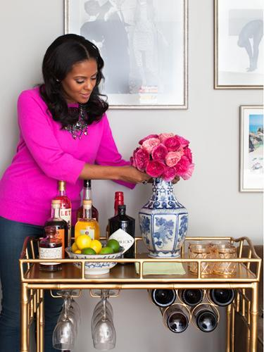 """<div class=""""caption-credit"""">Photo by: Stephanie Stanley</div><div class=""""caption-title"""">Flower power</div>Presentation is everything, says Gibbons. """"If you're using your bar cart as a multipurpose piece, try styling the top with a lamp, a small vase of fresh and colorful flowers, a few coffee table books, and some chic decorative objects while leaving the bottom shelf for your alcohol and other bar essentials."""" Here, she used in-season garden roses to add a pop of color to the metallic cart, arranging the fuchsia buds in a tight ball formation and banding the stems together using florist's tape. """"I like loose arrangements generally, but this one worked with the festivity of the gold,"""" she explains. <ul> <li> <b><a rel=""""nofollow noopener"""" href=""""http://www.redbookmag.com/recipes-home/tips-advice/party-food-recipes?link=relt&dom=yah_life&src=syn&con=blog_redbook&mag=rbk"""" target=""""_blank"""" data-ylk=""""slk:The 30 Best Party Foods of All Time"""" class=""""link rapid-noclick-resp"""">The 30 Best Party Foods of All Time</a></b> </li> <li> <a rel=""""nofollow noopener"""" href=""""http://www.redbookmag.com/recipes-home/tips-advice/classic-cocktails?link=relt&dom=yah_life&src=syn&con=blog_redbook&mag=rbk"""" target=""""_blank"""" data-ylk=""""slk:6 Classic Cocktails to"""" class=""""link rapid-noclick-resp""""><b>6 Classic Cocktails to</b></a> </li> </ul>"""
