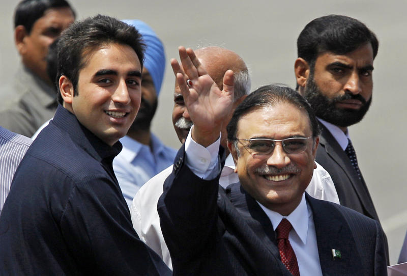FILE - In this Sunday, April 8, 2012 file photo, Pakistan President Asif Ali Zardari, right, waves while arriving at the Palam Airfield with his son Bilawal Bhutto Zardari, left, in New Delhi, India. Zardari, the elder, will not be participating in the upcoming election, but as co-head of the Pakistan People's Party, which led the last government, he will be a key figure. Bilawal Bhutto Zardari, the only son of the president and his late wife, is set to carry the torch for the Bhutto family political dynasty in Pakistan. Though he is too young to participate in the upcoming election himself, he will likely pay a key role as co-head of the PPP with his father. (AP Photo/Saurabh Das, File)