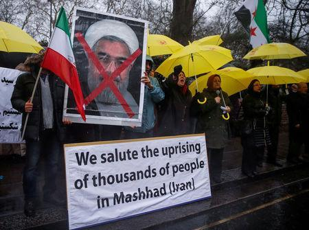 FILE PHOTO: Opponents of Iranian President Hassan Rouhani hold a protest outside the Iranian embassy in west London, December 31, 2017. REUTERS/Eddie Keogh/File Photo