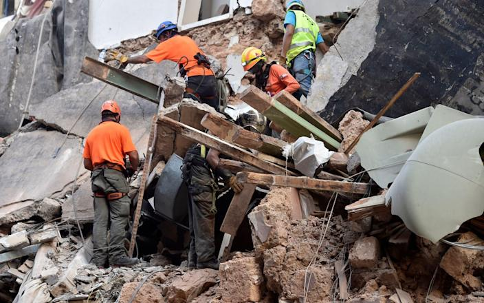 Rescue team from Chile work with Lebanese civil defense in a rescue mission after a scanner and a sniffer dog from the rescue team detected that there might be a survivor under the rubble