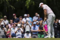 Rory McIlroy watches his putt on the third hole during the fourth round of the Wells Fargo Championship golf tournament at Quail Hollow on Sunday, May 9, 2021, in Charlotte, N.C. (AP Photo/Jacob Kupferman)