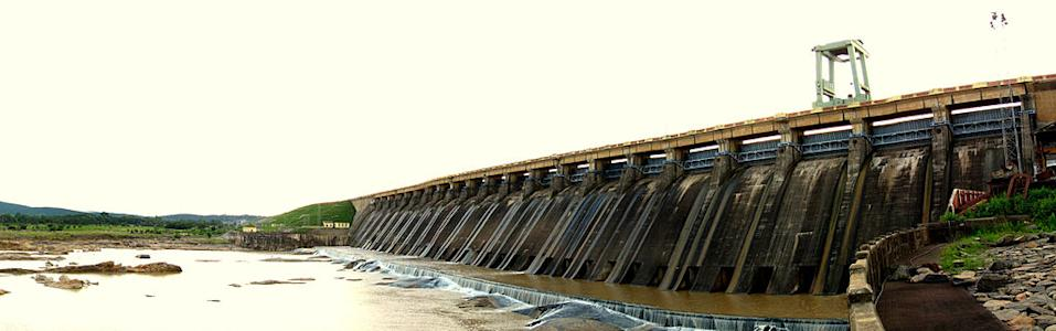 Hirakud Dam is built across the Mahanadi River, about 15 km from Sambalpur in the state of Orissa in India. Built in 1957, the dam is one of the world's longest earthen dam. Hirakud Dam is the longest man-made dam in the world, about 16 mi (26 km) in length. It is one of the first major multipurpose river valley project started after India's independence. [Photo by Quarterbacker (Own work) [CC-BY-3.0 (http://creativecommons.org/licenses/by/3.0)], via Wikimedia Commons]